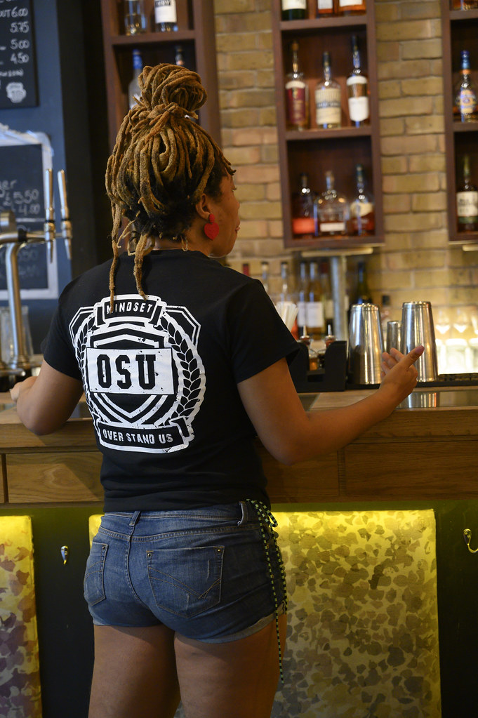 DSC_3134 Alesha from Jamaica out on the Town in Cut-off Denim Blue Jeans and Our Lives Matter Mindset Over Stand Us OSU Black Tee Shirt at The Jones Family Project JFP Cocktail Bar and Restaurant Shoreditch London Great Eastern Street