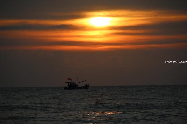 Vietnam sunset fishing boat