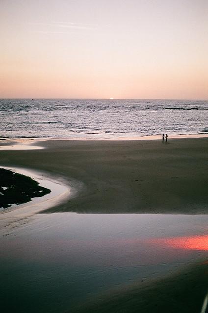 sun melting in the sea