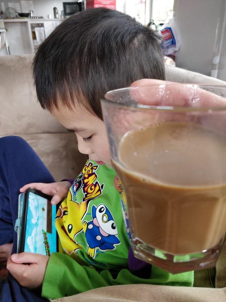 Enjoying Julia's caffe latte watching Liam play Geometry Dash in Roblox