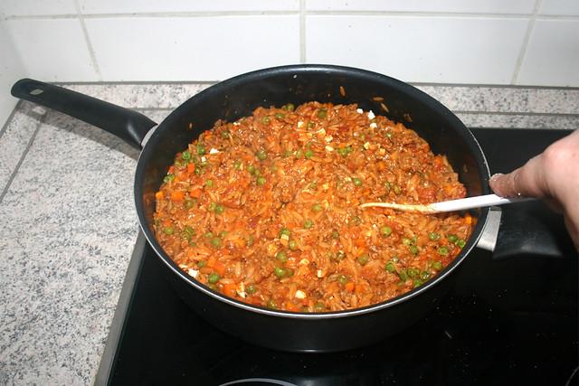 28 - Fold in & let melt feta / Feta verrühren & schmelzen lassen