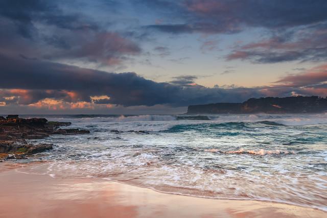 Rain Clouds and a Sunrise Seascape