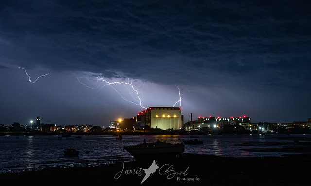 Lighting dances across the sky behind the Devonshire Dock Hall at BAE Systems Submarines in Barrow-in-Furness