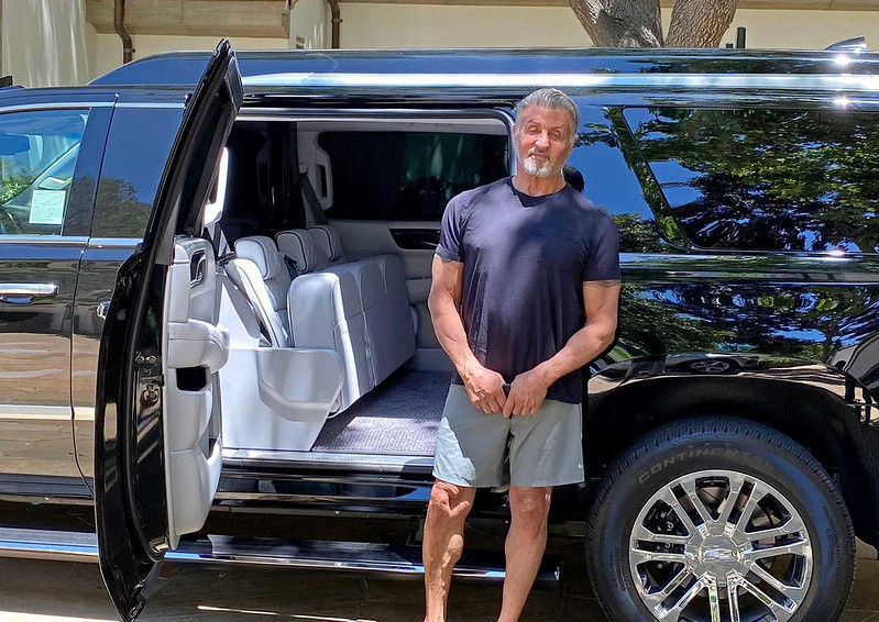 sylvester-stallone-next-to-his-custom2019-cadillac-escalade-esv