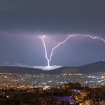 9. August 2020 - 2:03 - This night storm had *a lot* of 'upward' lightning or GCs (Ground-to-Cloud lightning). This one stems from a wind turbine which is on the peak of a mountain under the cloud layer. NW parts of Athens are also visible.  Photography and Licensing: doudoulakis.blogspot.com/  My books concerning natural phenomena / Τα βιβλία μου σχετικά με τα φυσικά φαινόμενα: www.facebook.com/TaFisikaFainomena/