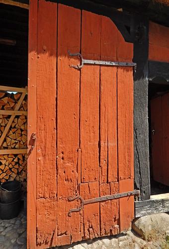 Old red door in the 1864 village of the large open-air museum in Aarhus, Denmark