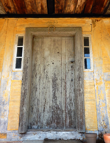 An old green door in the 1864 village of the large open-air museum in Aarhus, Denmark