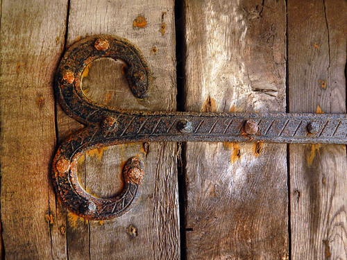 Wrought iron hinge on an old door in the 1864 village of the large open-air museum in Aarhus, Denmark