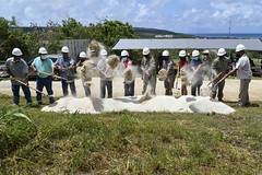 Officials break ground during a ceremony in Marpo Heights for a DoD Innovative Readiness Training road repair improvement project. (U.S. Navy/CE3 Marcus Henley)