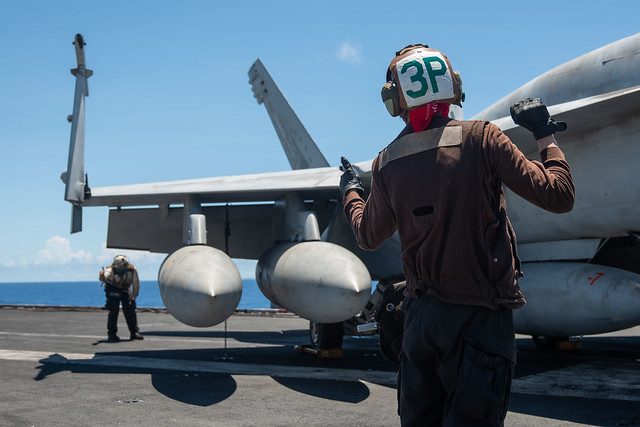 PHILIPPINE SEA (Aug. 12, 2020) Airman Adrian Belmonte, from Glendale, California, right, and Aviation Machinist's Mate 3rd Class Robert Robertson, from Reedsburg, Wisconsin, assigned to the Eagles of Strike Fighter Squadron (VFA) 115 conduct preflight checks of an F/A-18E Super Hornet on the flight deck of the Navy's only forward-deployed aircraft carrier USS Ronald Reagan (CVN 76). Ronald Reagan, the flagship of Carrier Strike Group 5, provides a combat-ready force that protects and defends the United States, as well as the collective maritime interests of its allies and partners in the Indo-Pacific region. (U.S. Navy photo by Mass Communication Specialist 2nd Class Samantha Jetzer)