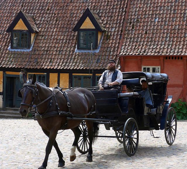 Old village horse & carriage in the 1864 village of the large open-air museum in Aarhus, Denmark