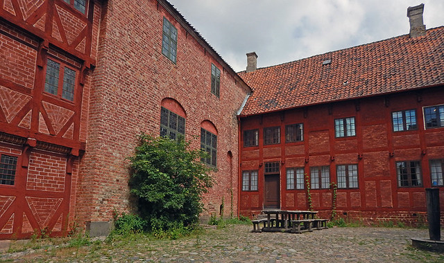 Farmhouse courtyard in the 1864 village of the large open-air museum in Aarhus, Denmark