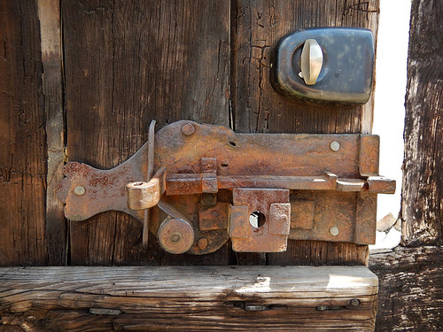 An old latch and something a tad newer in the 1864 village of the large open-air museum in Aarhus, Denmarklocks7431w