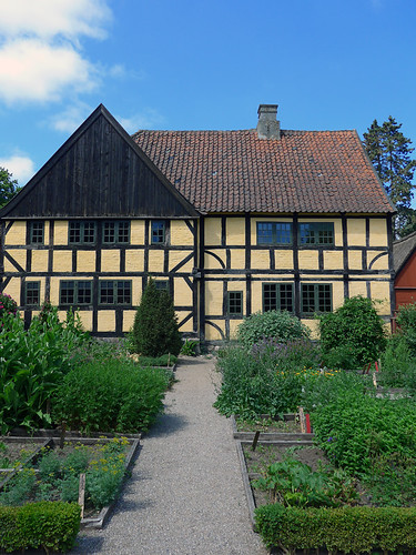 A grand house and garden in the 1864 village of the large open-air museum in Aarhus, Denmark