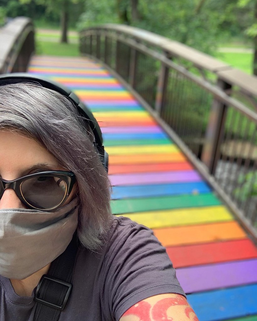 Grey hair and a grey mask with a rainbow bridge