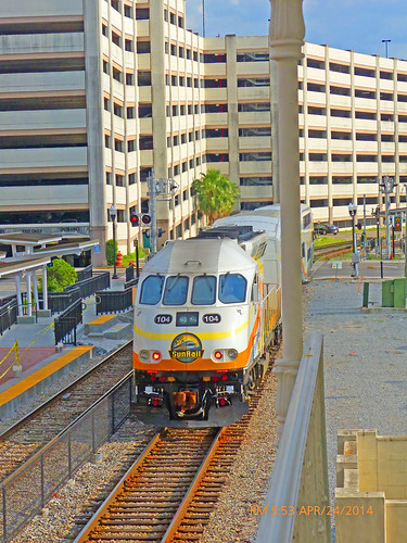 sunrail orlando orlandometroarea orlandometropolitanarea downtownorlando orlandoflorida fl unitedstates usa us america downtown commuterline train trainstation beforeofficialopening employeepractice testingthecommutertrain testingthecommuterline sunrailtesting doubledeckers passengertrains railcars rightofway row commercialcenter commercialarea station depot railroad churchstreetstation doubledeckerpassengercoach rails railroadtracks track ballast ties platforms skyscrapers buildings architecture fences canopies canopy parkinggsrages longtermparking shorttermparking surfaceparkinglot stairs movingoutofview movingsouthbound partlycloudy mostlybluesky bluesky lightclouds frontcoupler pavers redpavers pushpulloperation cabcar locomotive diesellocomotive dieselengine engine windows windshields openingdaymay12014 operatorsbombardiertransportation locomotivenumber104 engineno104 locomotive104 rrcrossingsignals 4sectionwindshield fourwindshields