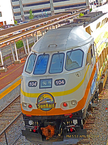 sunrail orlando orlandometroarea orlandometropolitanarea downtownorlando orlandoflorida fl unitedstates usa us america downtown commuterline train trainstation beforeofficialopening employeepractice testingthecommutertrain testingthecommuterline sunrailtesting doubledeckers passengertrains railcars rightofway row commercialcenter commercialarea station depot railroad churchstreetstation doubledeckerpassengercoach rails railroadtracks track ballast ties platforms skyscrapers buildings architecture fences canopies canopy parkinggsrages longtermparking shorttermparking surfaceparkinglot stairs movingoutofview movingsouthbound partlycloudy mostlybluesky bluesky lightclouds frontcoupler pavers redpavers pushpulloperation cabcar locomotive diesellocomotive dieselengine engine windows windshields openingdaymay12014 operatorsbombardiertransportation viewfromabove locomotivenumber104 engineno104 locomotive104 rrcrossingsignals