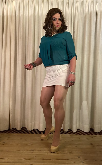 cyan see-through top with white skirt front view