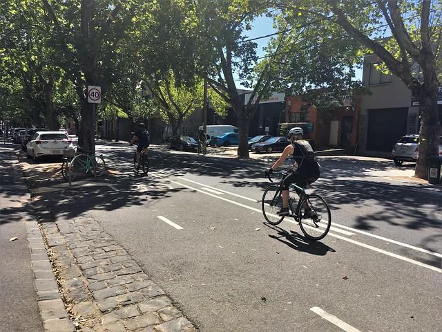 People riding bicycles along Nicholson Street, Abbotsford