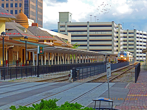 sunrail orlando orlandometroarea orlandometropolitanarea downtownorlando orlandoflorida fl unitedstates usa us america downtown commuterline train trainstation beforeofficialopening employeepractice testingthecommutertrain testingthecommuterline sunrailtesting doubledeckers passengertrain railcars rightofway row commercialcenter station depot railroad churchstreetstation doubledeckerpassengercar rails railroadtracks track ballast ties platform skyscrapers buildings architecture fences canopies canopy parkinggarage longtermparking shorttermparking surfaceparkinglot movingoutofview moving movingsouthbound partlycloudy mostlybluesky bluesky lightclouds pavers redpavers pushpulloperation cabcar locomotive diesellocomotive dieselengine engine windows windshield openingdaymay12014 operatersbombardiertransportation locomotivenumber104 engineno104 locomotive104 signs lampposts