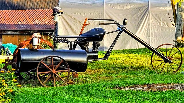 Robot heads on a steampunk motortrike?