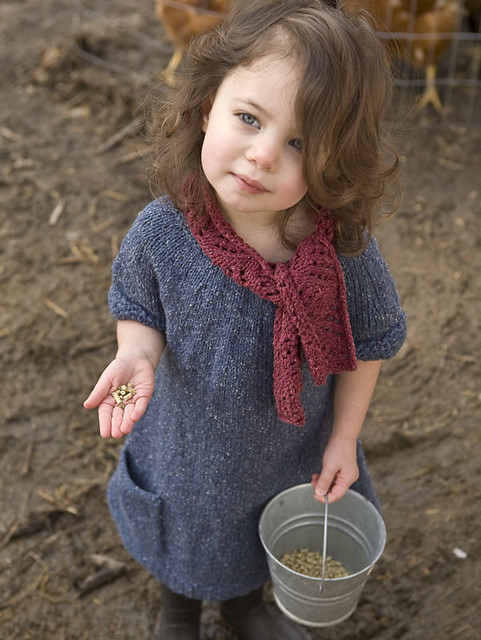 Simo by Cirilia Rose is a little dress with short sleeves, pockets, a circular yoke and a sewn-on scarf! Knit using Berroco Remix.