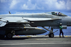 An F/A-18E Super Hornet assigned to Strike Fighter Squadron (VFA) 195 prepares to launch from USS Ronald Reagan (CVN 76) during operations in the South China Sea, Aug. 14. (U.S. Navy/MC3 Jason Tarleton)