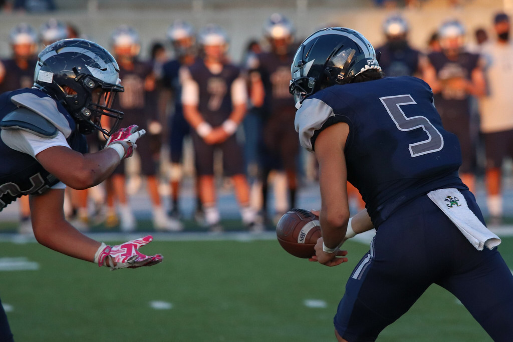 Hunter RB Lorenzo Tua'one takes the handoff from Justin Brusatto