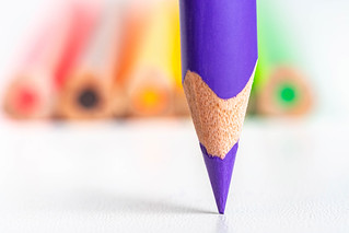 Close-up, tip of purple pencil on blurred background of colored pencils | by wuestenigel