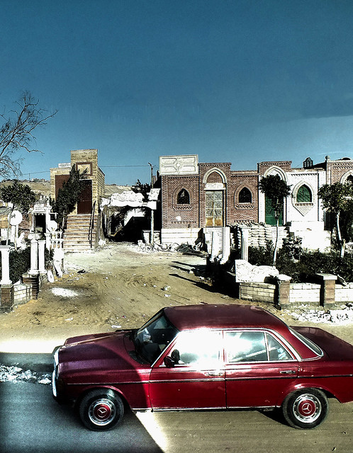Cairo city of the Dead and a red Car