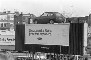 Hoarding, car, West Cromwell Rd,  Kensington, Kensington & Chelsea, 1987 87-12c-54-positive_2400