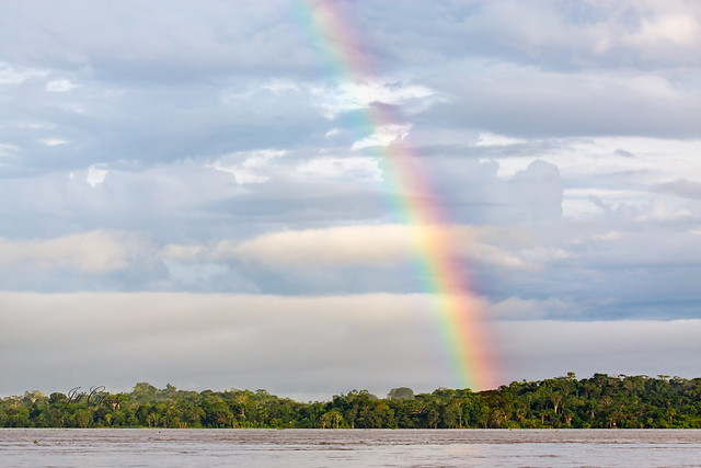 Armchair Traveling - Rainbow Over the Amazon River