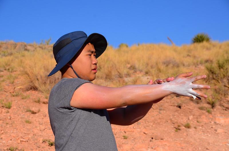 Jacob putting on sunscreen