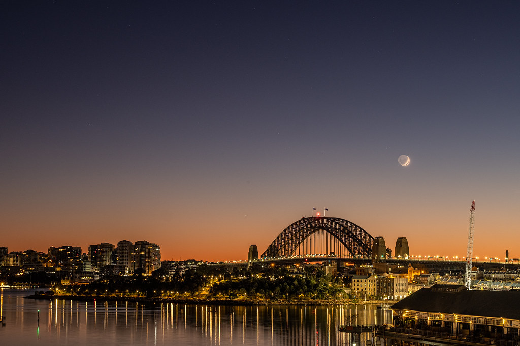 Looking across Darling Harbour to Barangaroo Reserve and the Sydney Harbour Bridge, first light, clear skies and the crescent moon are my early morning companions.