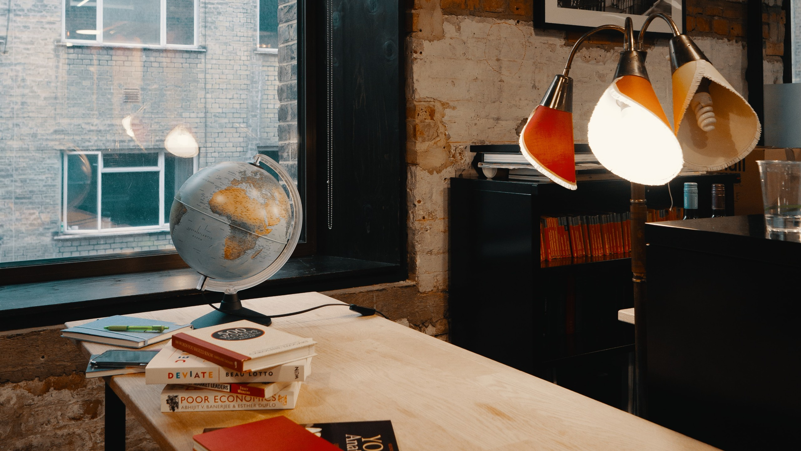 a globe and text books on a table