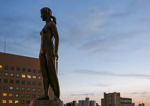 hokkaido japan kushiro sunset statue sculpture art spring girl bridge nusamai