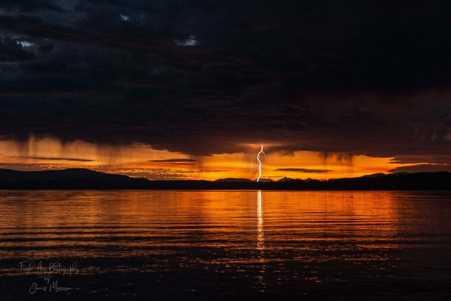 Final light with a lightning strike - Pat Bay, North Saanich, BC