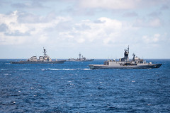 In this file photo, U.S. Navy and Royal Australian Navy ships steam together during RIMPAC 2018. (U.S. Navy/MC2 Devin M. Langer)