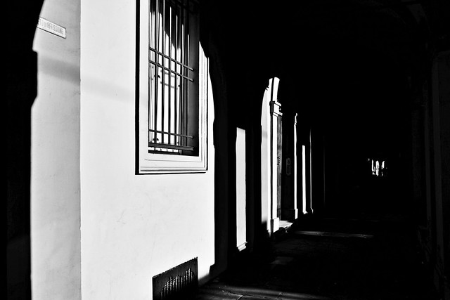 Shadows and lights under the arcades of Bologna---abstract urban