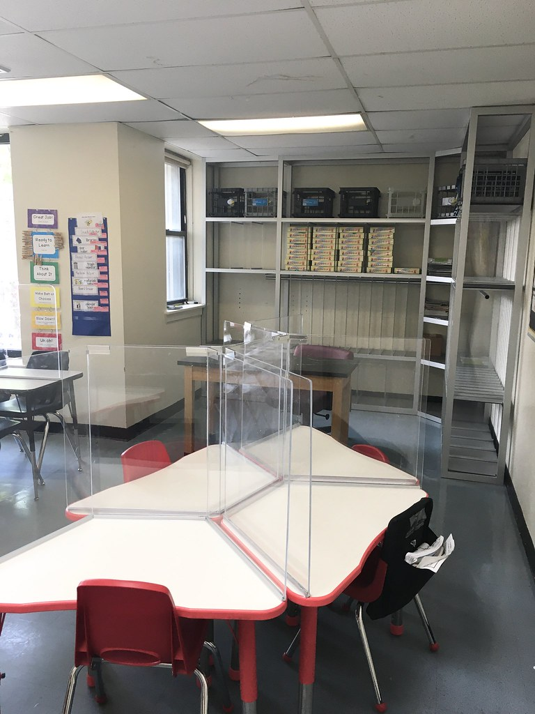 Model classroom with small group instruction tables and cubbies