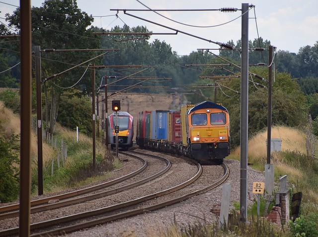 GBRf slows down on Haughley Bank, in readiness to take the Junction for the Bury Branch, at the head of the 13.21 Felixstowe Spouth - Masborough Intermodal. 18 08 2020