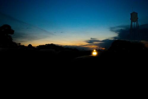 bnsf empty grain train up glidden sub waelder tx texas silhouette sunset watertower lights railroad