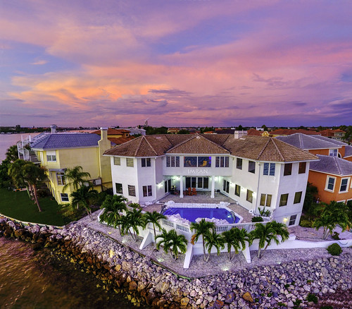 apollobeach clouds dusk east florida flying home imran panorama sunset tampabay aerial dramatic drone maghreb pastels pink swimmingpool chairs reflections water rooftop architecture lifestyle luxuryhomes realestate