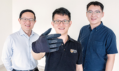 The InfinityGlove was developed by a team of NUS researchers led by Professor Lim Chwee Teck (left). With him are two members of the research team, Dr Yeo Joo Chuan (centre) and Dr Yu Longteng (right). Photo: National University of Singapore.