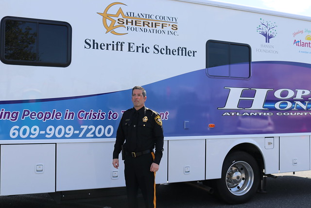 A sheriff in front of the Hope One Mobile Unit