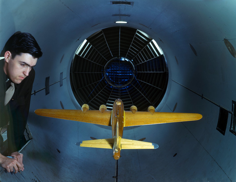 Army Air Forces engineer examines a B-17