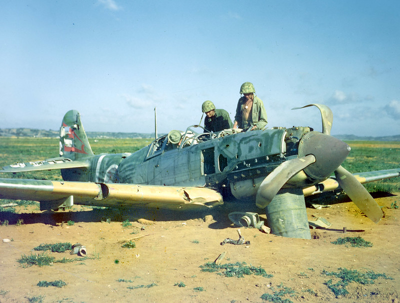 Marines look over abandoned Japanese Kawasaki Ki-61