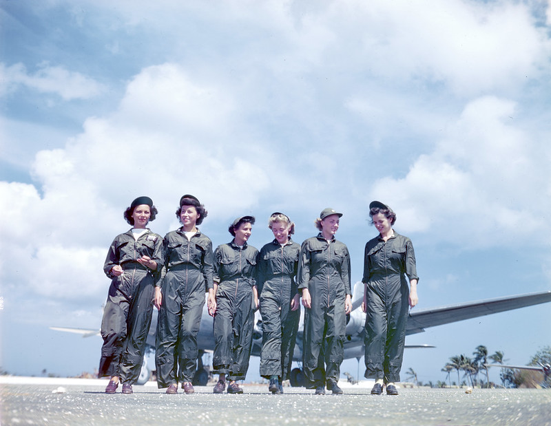 Navy flight nurses walks from their Douglas R5D (C-54)