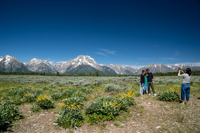 Grand Teton National Park, Wyoming - June 26, 2020: Tourist family poses for photos at a scenic pullout in the National Park on a summer day