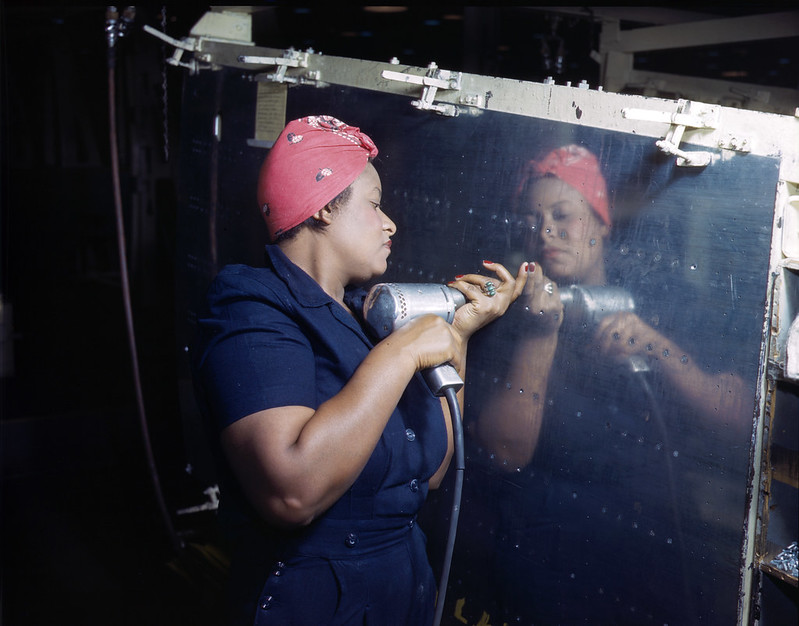 A riveter works on a Vultee A-31 Vengance